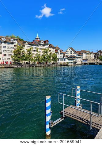 Zurich, Switzerland - 18 June, 2017: the Limmat river, old town buildings along it. Zurich is the largest city in Switzerland and the capital of the Swiss canton of Zurich.