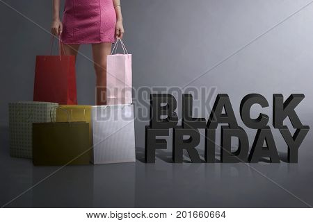 Young Shopper Holding Shopping Bag Standing With Black Friday Text