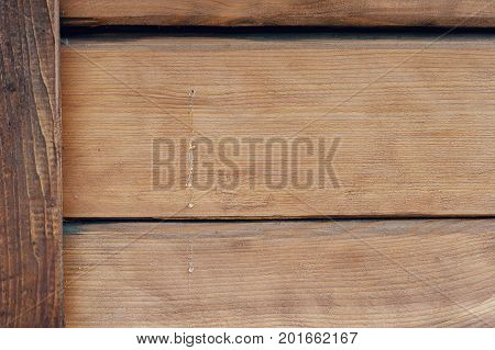 Texture of wood with flowable resin, on the wall of a house made of wood