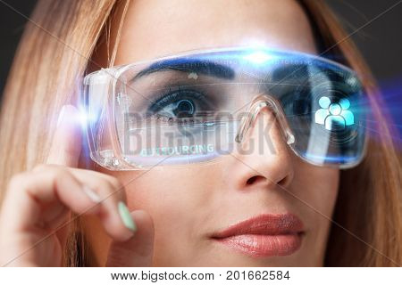 Young Businesswoman Working In Virtual Glasses, Select The Icon Outsourcing On The Virtual Display