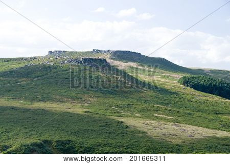 Derbyshire, UK: 31 Oct 2014: View of Carl Wark ancient hill fort from across the moor on 31 Oct in the Peak District