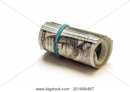 A coiled 100 dollar bill isolated on white background. Bank. Casino. Cash