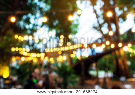 abstract night light bokeh of night festival in garden light blurred background vintage color tone