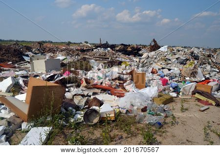 Nature near Ukrainian capital.Environmental contamination. Illegal junk dump. August 24, 2017.Near Kiev, Ukraine
