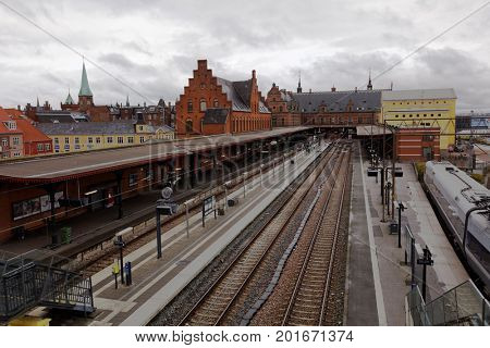 HELSINGOR, DENMARK - NOVEMBER 6, 2016: Railroad tracks and platform of train station of Helsingor. The station was built in 1863 as the terminus of the North Line from Copenhagen