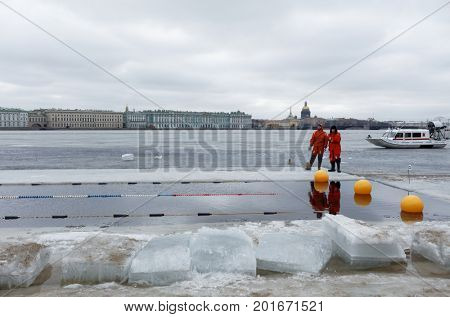 ST. PETERSBURG, RUSSIA - MARCH 18, 2017: Emercom squad on duty during the winter swimming competitions in river Neva. The event aimed to revive the winter swimming tradition dated back to 1960-1990s