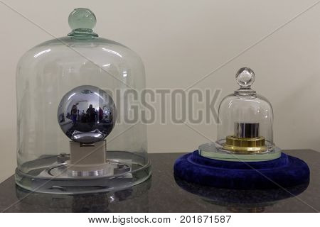 ST. PETERSBURG, RUSSIA - APRIL 25, 2017: National standard of the unit of mass in form of silicon sphere and platinum cylinder in D.I. Mendeleyev Institute for Metrology. Institute was founded in 1842