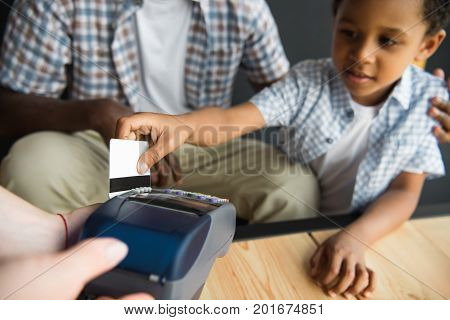 Father And Son Paying Bill