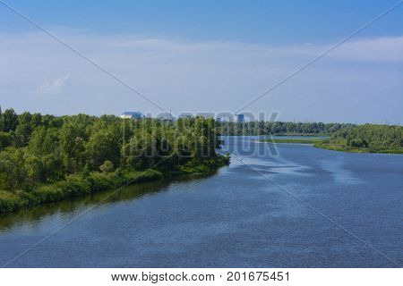 A beautiful river landscape and trees in a dead radioactive zone. Consequences of the Chernobyl nuclear disaster August 2017.