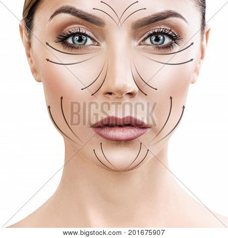 Beautiful adult woman face with massaging arrows on face. Anti-aging therapy concept.