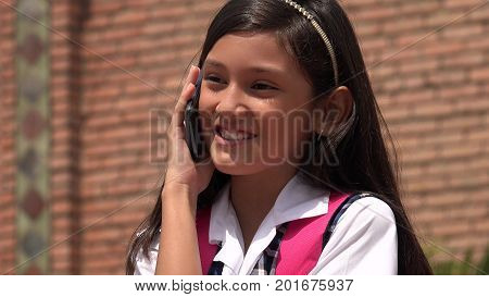 Pretty Female Using Cell Phone And Happy