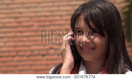 Youthful Girl Using Cell Phone And Happy