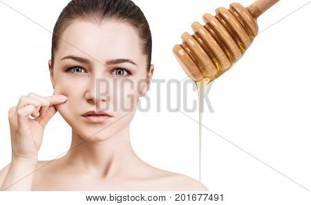 Young woman and honey spoon prepare for facial mask. Honey treatment concept.