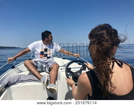 People on a speed boat