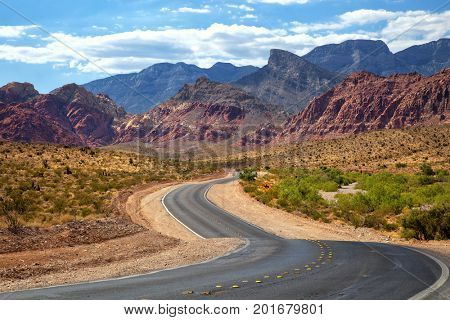 Road into Red Rock Canyon in Nevada with mountains in background