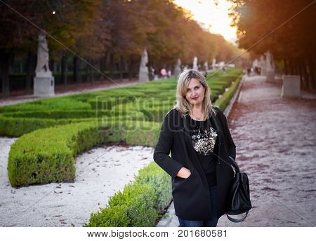 Young girl in the park in autumn day