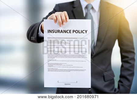 businessman show insurance policy, house, health, car, travel
