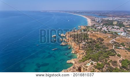 Aerial. Type of coastal spit and beaches of Alvor Tres Irmaos. Portimao