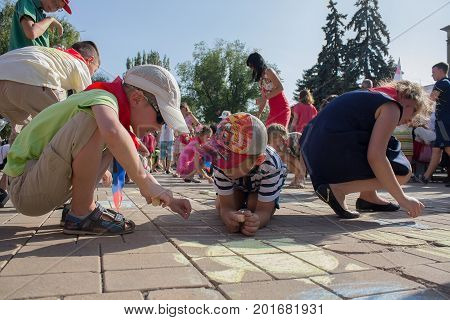 Donetsk Ukraine - August 27 2017 - Children paint with chalk on the asphalt at the celebration of the City Day
