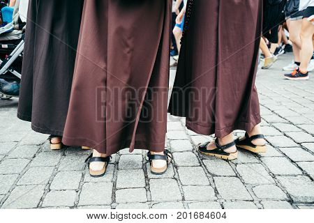 nun feet in crowd in holiday celebration