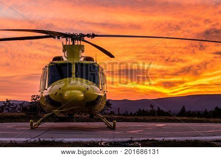 A wildfire helicopter view on a spectacular sunset
