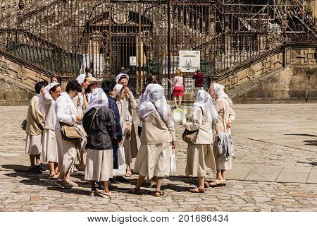 SANTIAGO DE COMPOSTELA, SPAIN. AGUST 9, 2017. A group of nuns meet in front of the Santiago's Cathedral probably to visit the holy town.
