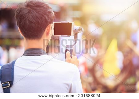 Man Using Modern Smartphone Record Video. Outdoor Setup And Working