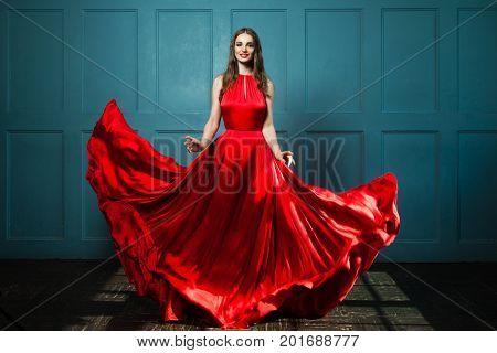 Glamorous Woman in Fashionable Red Dress. Beautiful Fashion Model Full Portrait