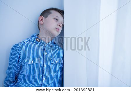 Worried Boy Spends Afternoon Alone
