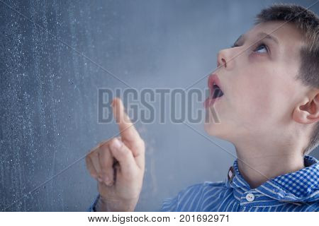 Boy Watches Rain