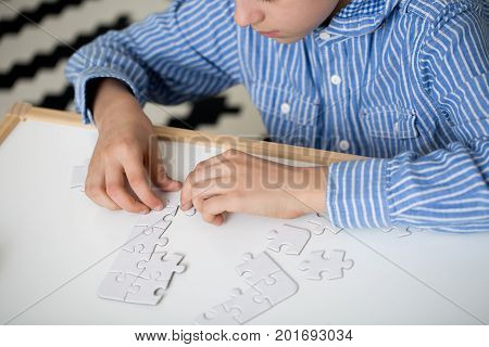 Boy Doing Puzzles
