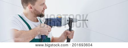 Man With Electric Drill