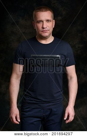 Serious Casual Man On Black Background