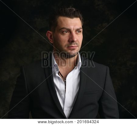 Handsome Man Looking Away On Black Background
