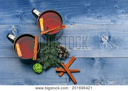 Tea Or Mulled Wine With Cinnamon, Fir, Pinecone At Christmas