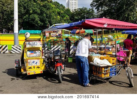 Vendors Sell Food In Manila, Philippines