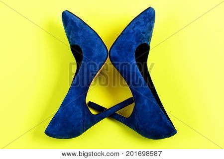 Elegant Blue Suede Shoes On Yellow Background