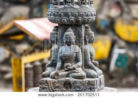 Buddha bas relief at the Swayambunath temple, Kathmandu, Nepal