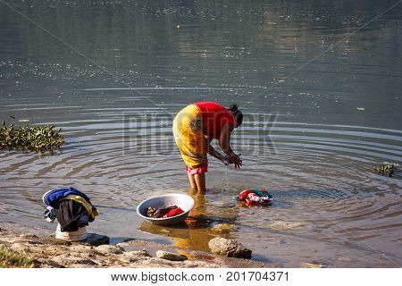 Woman Doing Laundry On The Phewa Lake, Pokhara, Nepal