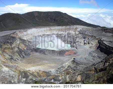 View of Poas volcano, in National Park Poas Volcano, Costa Rica. The crater with toxic water and gas.