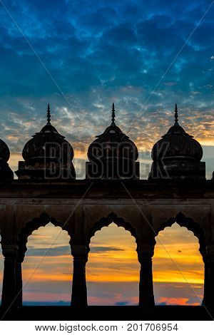Sunset silhouette of palace mehrab or arch of Imambara in Lucknow