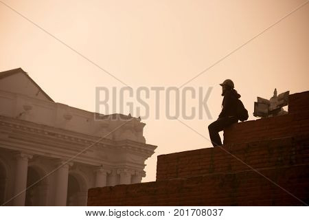 Tourist Looking The Durbar Square From A Temple, Kathmandu, Nepal