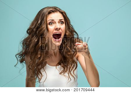 The portrait of Fright young woman with shocked facial expression