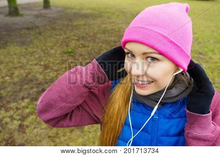 Teenage Sporty Girl Listening To Music Outdoor.