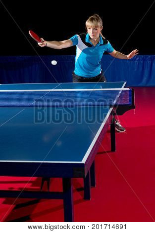 Young woman table tennis player isolated