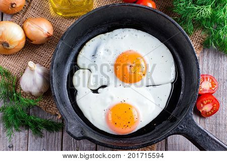 Fried eggs. Close up view of the fried egg on a frying pan