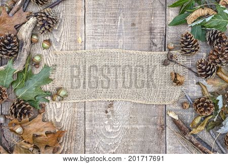 Rustic Burlap Banner, Blank Sign, On Weathered Wooden Background With Acorns, Pinecones, Leaves And