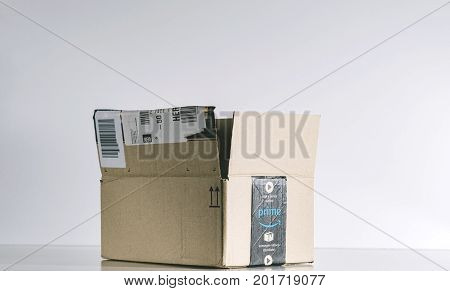 PARIS FRANCE - JUL 30 2017: Open Amazon Prime cardboard box side. Amazon is an American electronic e-commerce company distribution worlwide e-commerce goods