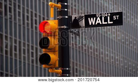 NEW YORK USA - JUNE 12 2010: View of traffic lights with black and white pointer guide in Wall Street New York City. Red traffic light to Wall street banks money dollars finance offices.