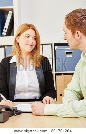 Woman giving financial or insurance advice to a Man during a meeting